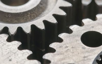 close-up image of gears turning against one another