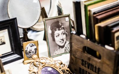 antique photographs and jewelry laying on a tabletop