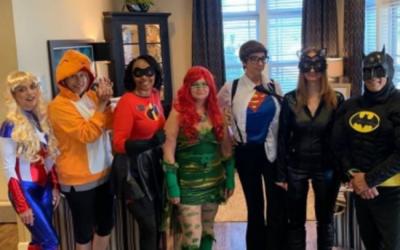 JEA team members dressed up as superheroes to celebrate national assisted living week